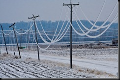 Power lines sag and break after a damaging ice storm hits northwest Missouri near Mound City, December 10-11 2007.